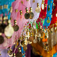A one hour belly dance party workshop gets your friends dancing and laughing.